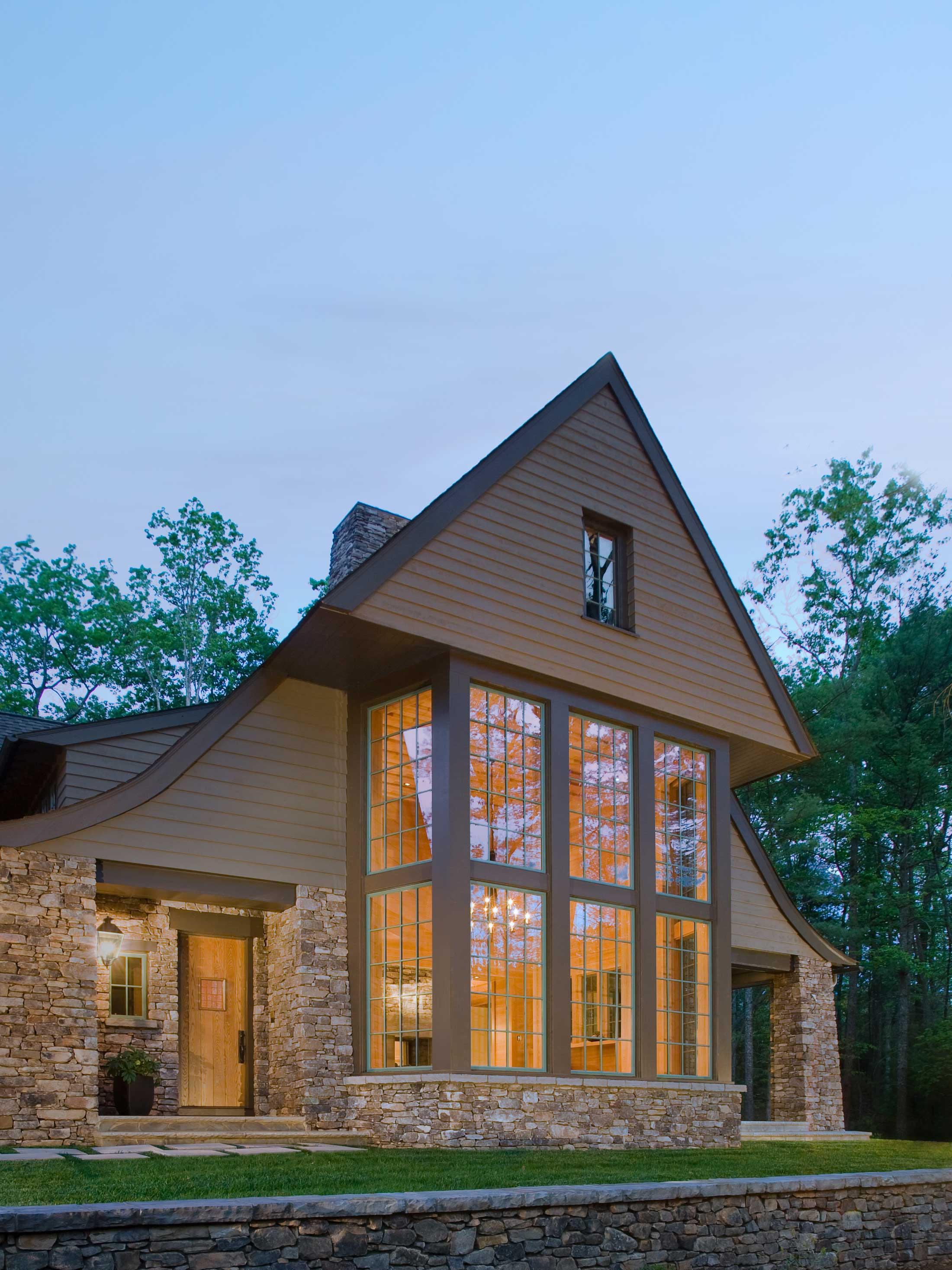 modern night light exteriors of mountain modern home-NC Healthy Built Home in Asheville