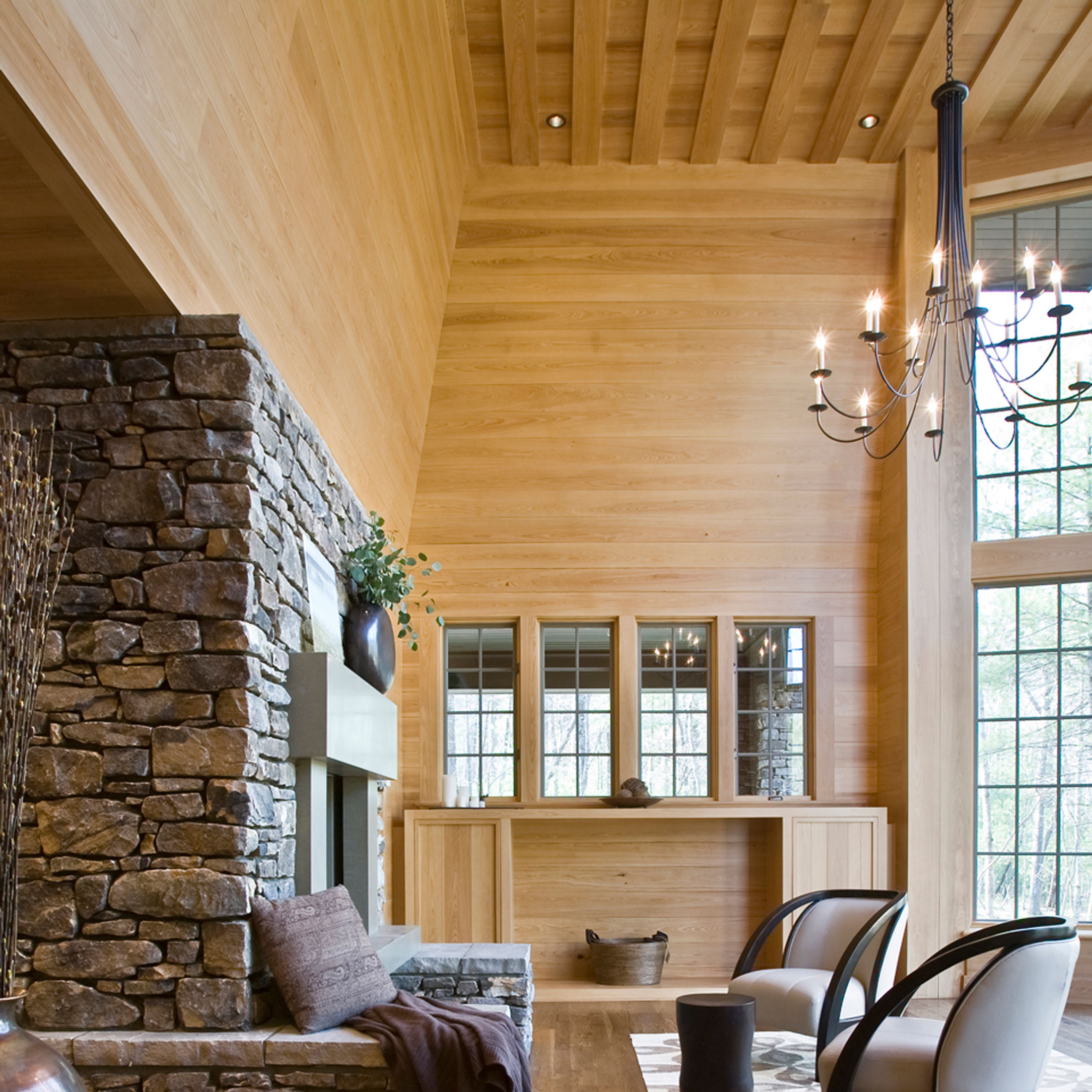 stone fireplace with wood wall floor to ceiling