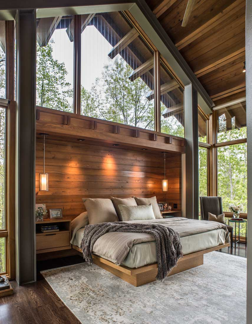 custom master bedroom with wood and glass walls