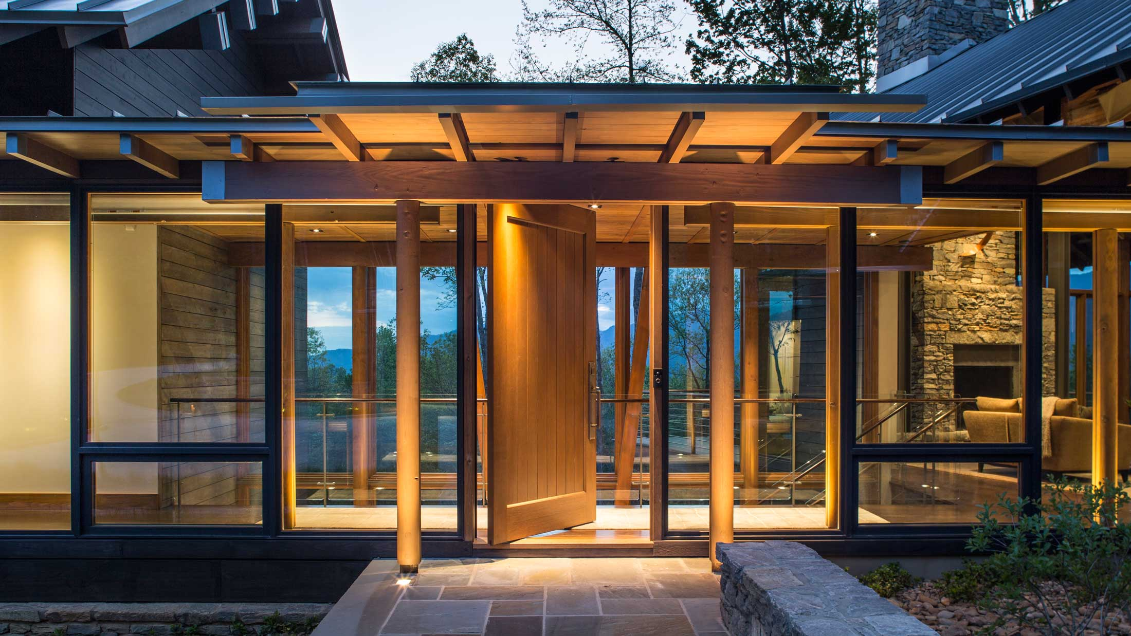front door entry with glass walls