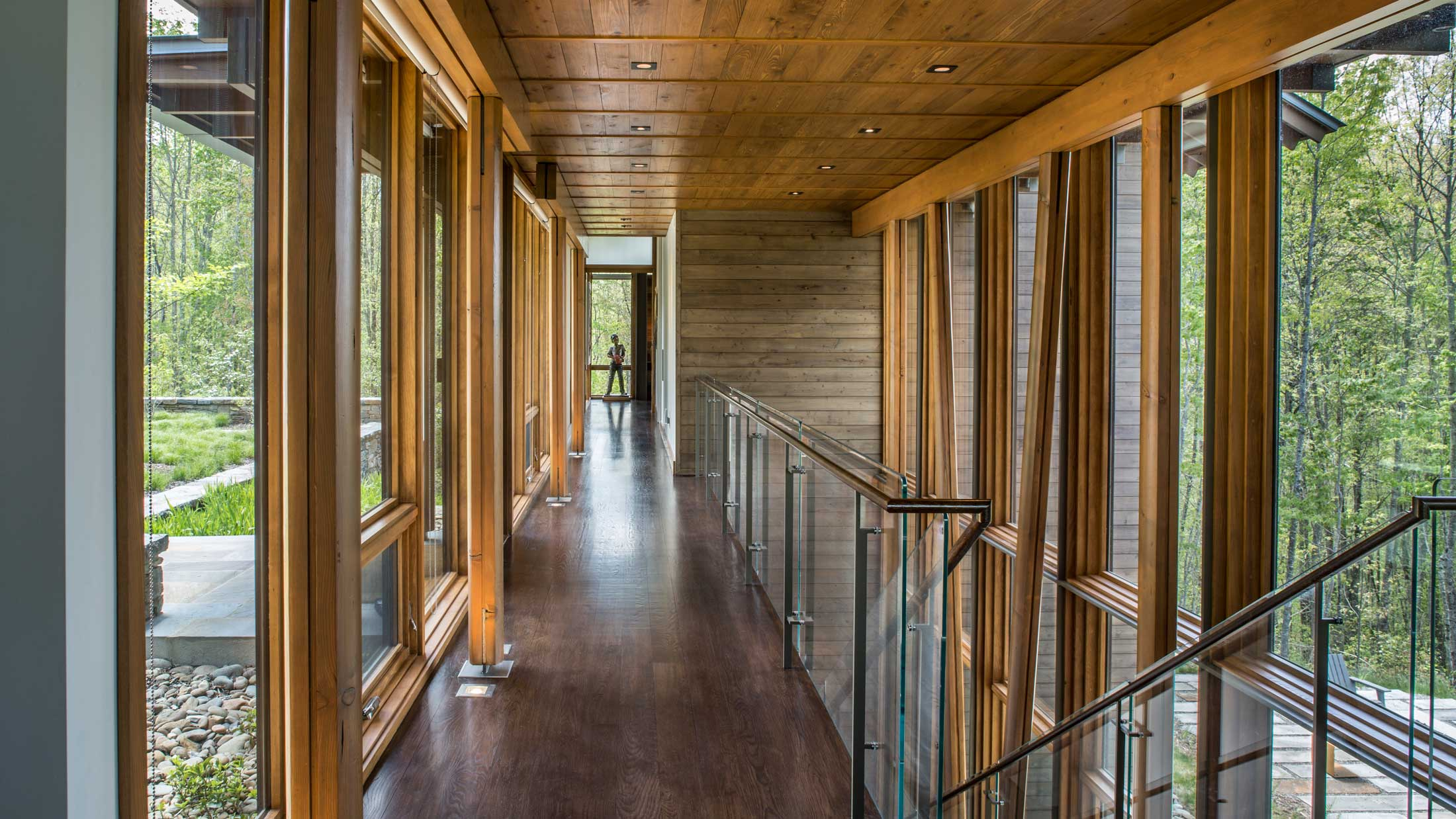 wood, steel and glass hallway and balcony