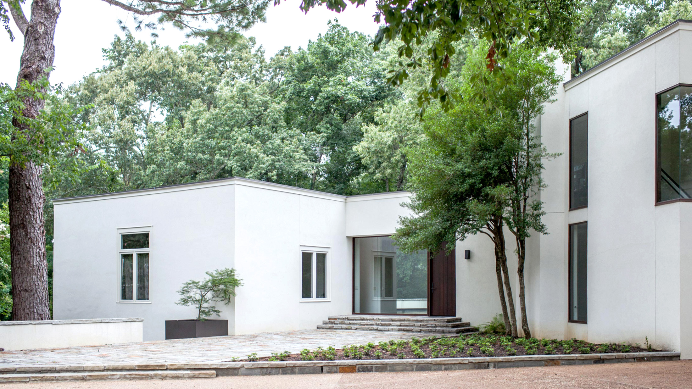 white stucco modern home-Memphis residential design firm