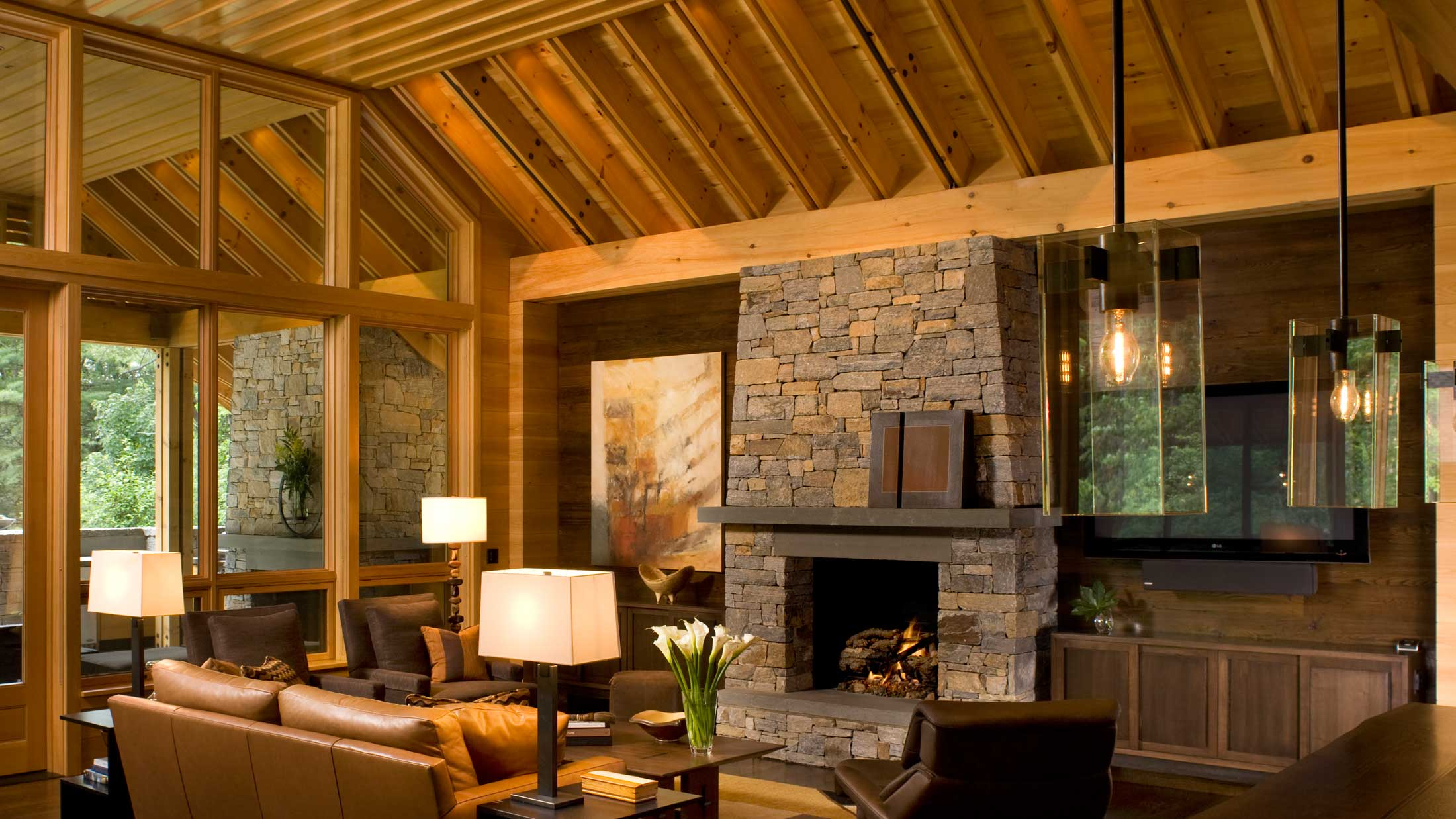 wood ceilings and stonework fireplace