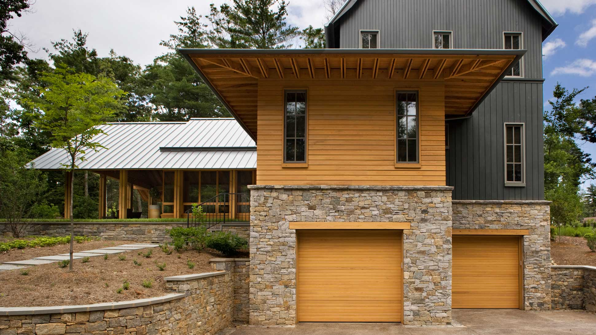 stone and wood siding garage entry