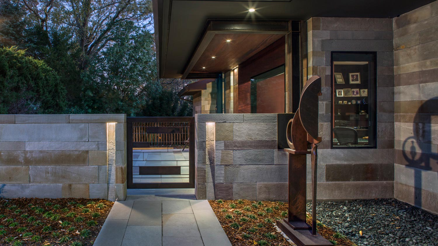 entry gate-stone and wood-evening lit