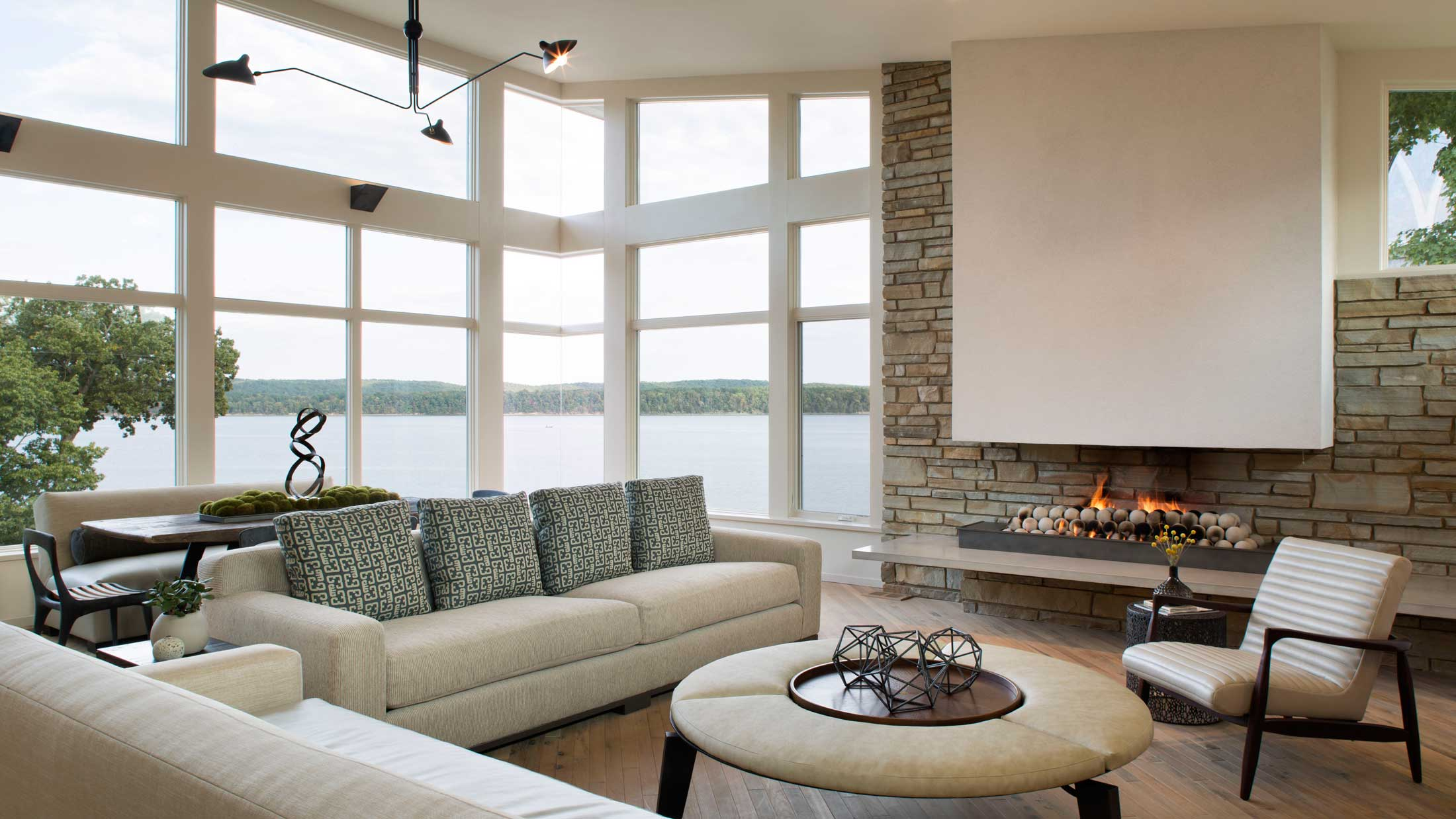 view of lake-modern living room with floating fireplace