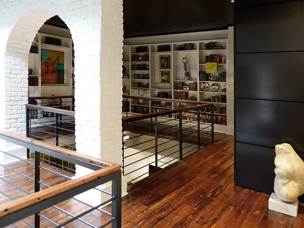 library with balcony in downtown loft apartment