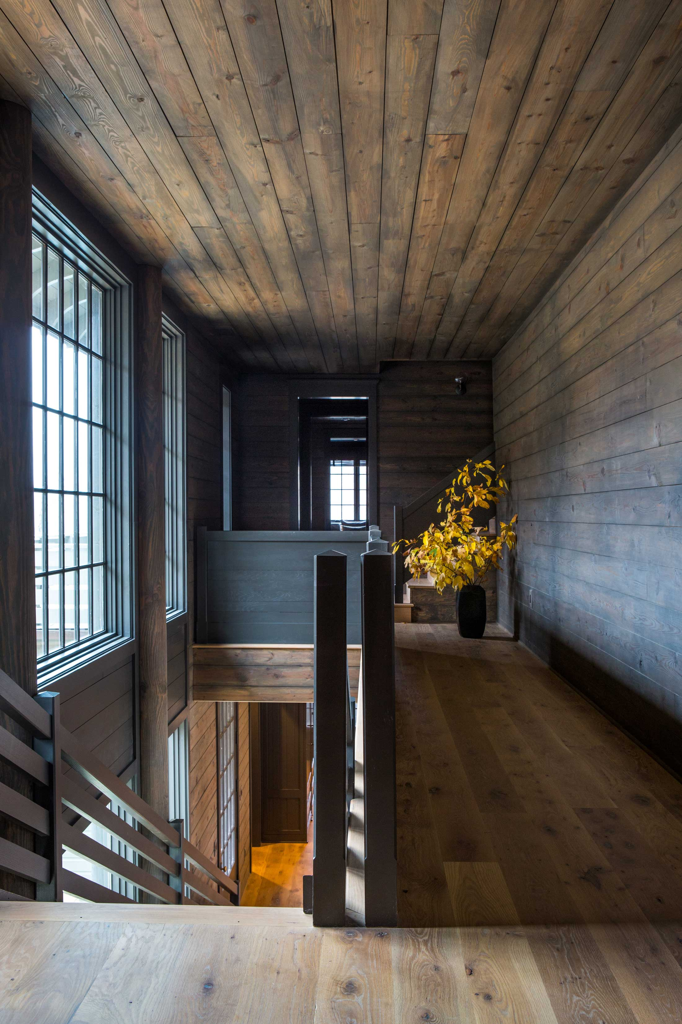 lake house hallway with wood floor to ceiling-staircase
