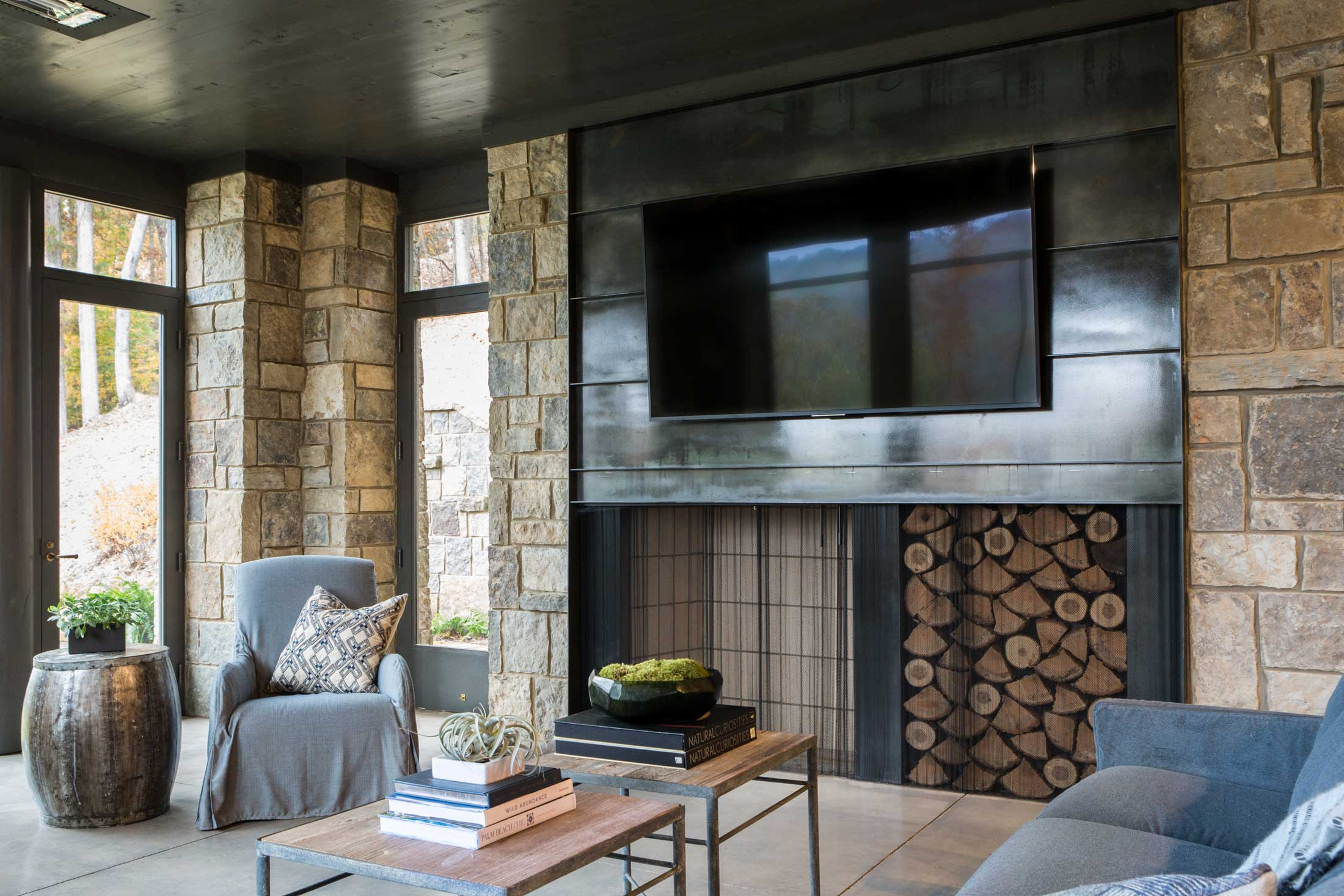 lake house covered porch fireplace