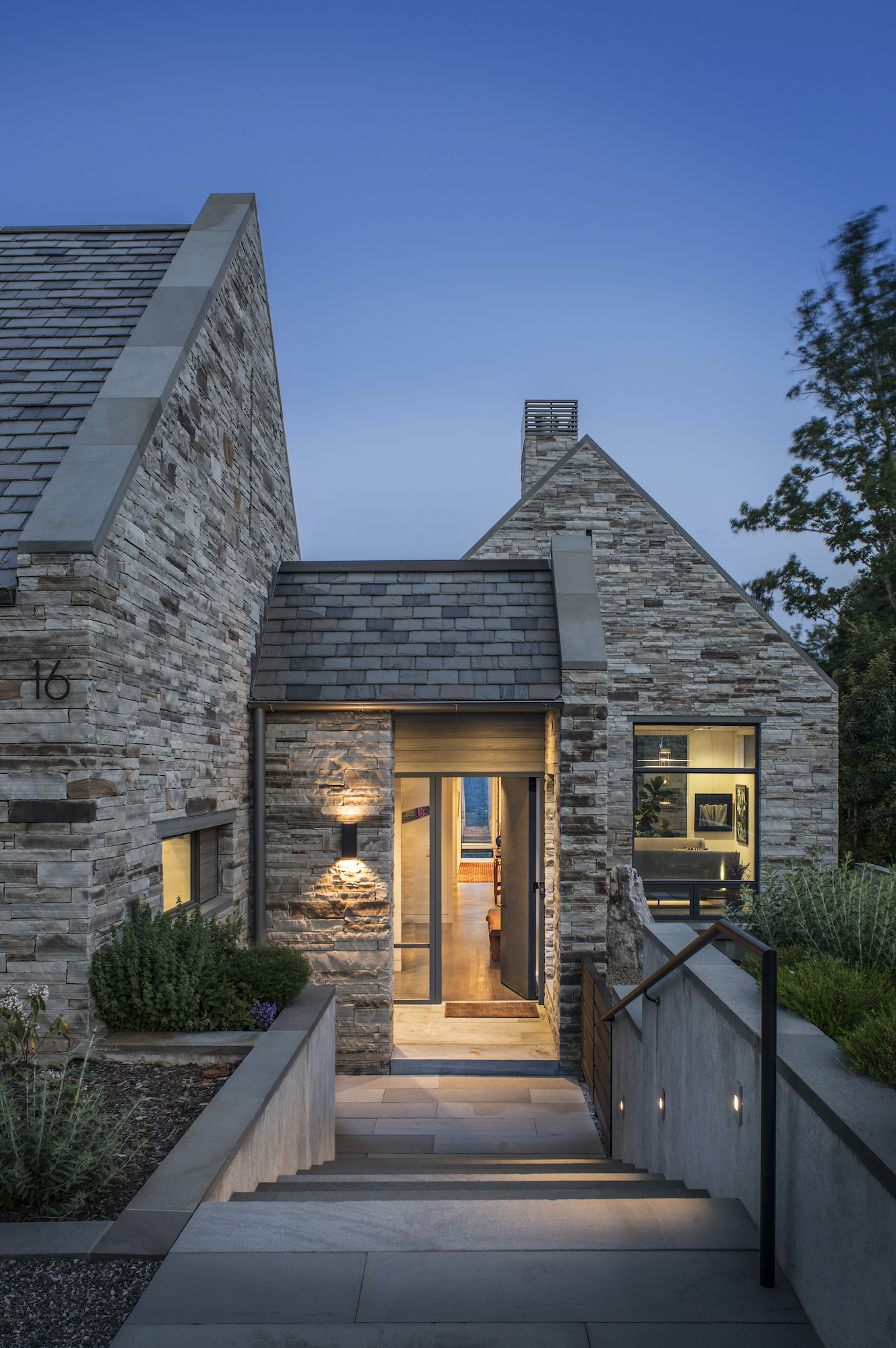 native stone on modern home by Carlton Edwards Architects